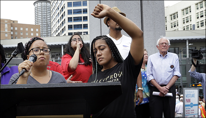 Marissa Johnson, left,  Mara Jacqueline Willaford and Sen. Bernie Sanders, far right  (AP Photo/Elaine Thompson)